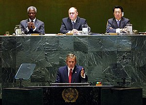 Jan Kavan - Jan Kavan as President of the United Nations General Assembly (below him President of the United States George W. Bush)