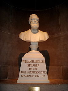 A bust of a bearded man