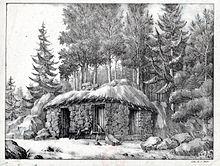 Un homme tenant un livre et un chien, assis devant une cabane en pierres au toit de chaume. Derrière, des sapins.