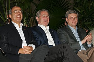 President George W. Bush (center) joins Mexico...