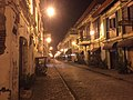 Calle Crisologo at night in Vigan City.jpg