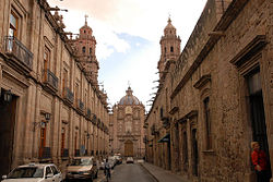 Street in the historic center with the Cathedral of Morelia at the end