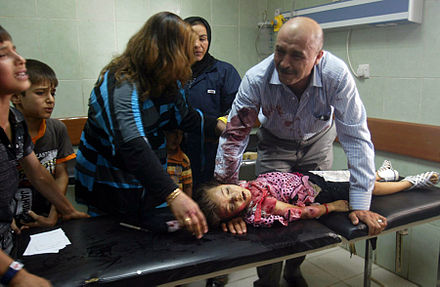 Child killed by a car bomb in Kirkuk, July 2011 Car bomb victim in Iraq.jpg