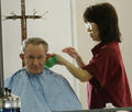 Charles Robert Jenkins getting haircut in Zama, Japan (September 13, 2004) (cropped).png