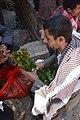 Checking the Qat, Yemen (14431358479).jpg