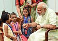 Children tying 'Rakhi' on the Prime Minister, Shri Narendra Modi's wrist, on the occasion of 'Raksha Bandhan', in New Delhi on August 26, 2018 (2).JPG