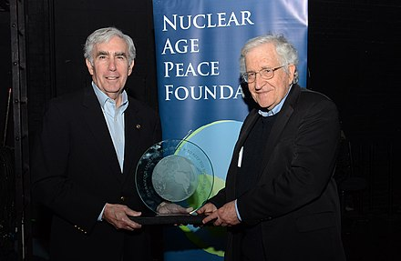 Chomsky receiving an award from the president of the Nuclear Age Peace Foundation, David Krieger (2014) Chomsky and Krieger.jpg