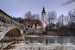 Church of st. John the Baptist at Lake Bohinj, next to the bridge.jpg