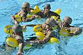 Coast Guardsmen with Maritime Safety and Security Team 91110 form a human raft during water survival training.jpg