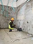 Contractor works on plumbing in Israel (5308373368).jpg