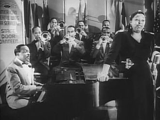 Ethel Waters - Waters performs with Count Basie in Stage Door Canteen (1943).