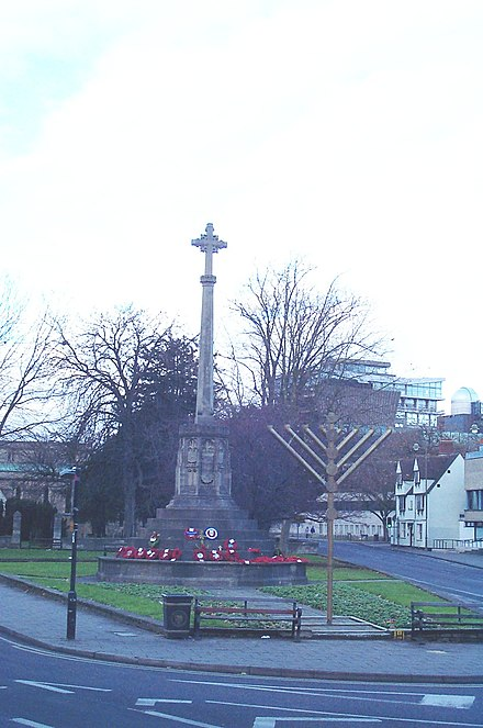 The cross of the war memorial and a menorah coexist in Oxford, Oxfordshire, England Cross menorah Oxford 20051225.jpg