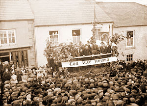 D. D. Sheehan - D. D. Sheehan MP (standing centre balcony), addressing large All-for-Ireland League rally in 1910 at Newmarket, County Cork.