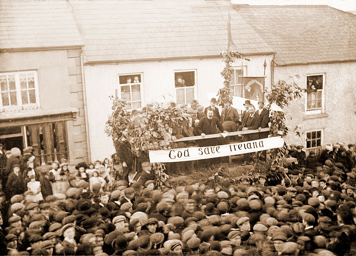 D. D. Sheehan MP (standing centre balcony), addressing large All-for-Ireland League rally in 1910 at Newmarket, County Cork. D. D. Sheehan at Newmarket, 1910.jpg