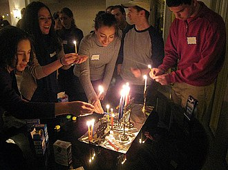 Washington, D.C. Jewish Community Center - Members of the DC Minyan light candles in celebration of the Festival of Hanukkah.