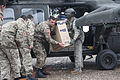 Defense.gov News Photo 120224-A-OD503-015 - A U.S. Army soldier right hands a box of humanitarian relief supplies to a Montenegrin soldier during a resupply mission in Mojkovac Montenegro.jpg