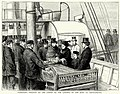 Depositing wreaths on the coffin on the landing of the body at Southampton.jpg