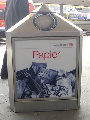 Paper recycling - Bin to collect paper for recycling in a German train station.