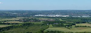Vale of Holmesdale - Looking south from Blue Bell Hill across the Medway Valley a deep part of the valley, with the village of Eccles in the foreground, the Aylesford Newsprint plant in the middle ground, Ditton and Maidstone beyond.