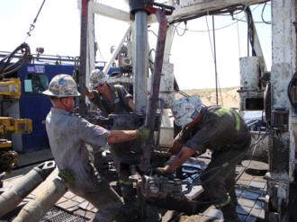 Roughneck - Roughnecks on a drilling rig.