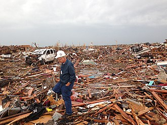 2013 Moore tornado - Meteorologist Tim Marshall surveys a neighborhood that was devastated.