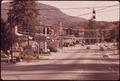 ENTRANCE TO LAKE GEORGE VILLAGE, IN THE ADIRONDACK FOREST PRESERVE IS CLUTTERED WITH POWER LINES AND SIGNS - NARA - 554709.tif
