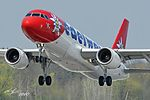 Edelweiss A320 take-off at the runway 16 of Zurich airport (4559177748).jpg