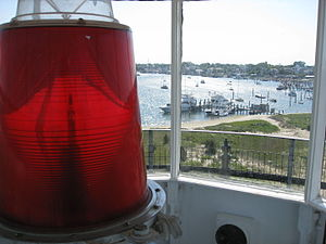 Edgartown Harbor Light - View of the lens of the Edgartown Harbor Light, with Edgartown Harbor in the distance.