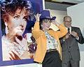 Elizabeth Taylor with purple cowboy hat at Neiman Marcus store, Dallas.jpg