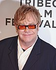 Elton John, with tinted glasses