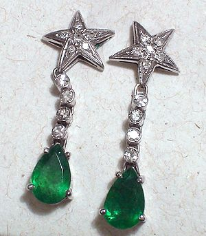 Earrings with natural emerald, diamond and whi...