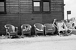 Empty chairs and parked bicycles leaning against a dispersal hut at Hornchurch aerodrome, 7 May 1942. CH5763.jpg
