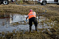 FEMA - 38434 - A recovery specialist cleans a small oil spill in Texas.jpg