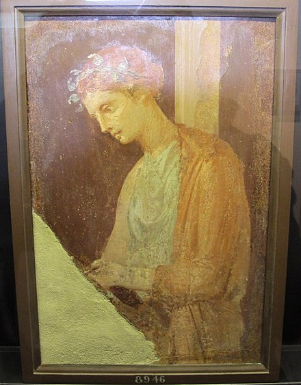 Roman fresco of a blond maiden reading a text, Pompeian Fourth Style (60-79 AD), Pompeii, Italy Fanciulla intenta alla lettura (IV stile), I sec, da pompei, MANN 8946.JPG