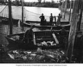 Fishermen harvesting salmon from fish traps, vicinity of the lower Columbia River, ca 1900 (INDOCC 632).jpg