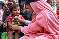 Flickr - DFID - A female doctor with the International Medical Corps examines a young boy at a mobile health clinic in Pakistan.jpg