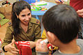 Flickr - Israel Defense Forces - Soldiers Celebrate Purim with At-Risk Children (2).jpg