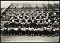 Football team sitting on bleachers, US Naval Training Station at University of Washington, 1917 (MOHAI 9117).jpg