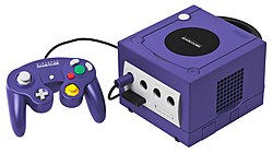 Indigo-colored GameCube with controller and memory card