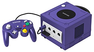 GameCube - An indigo Nintendo GameCube console with its controller and the 251-block memory card