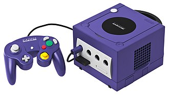 GameCube - An indigo GameCube console with its controller and the 251-block memory card