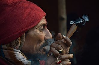 Recreational drug use - A man smoking cannabis in Kolkata, India.