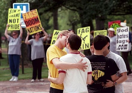 Students kissing in front of protesters from Westboro Baptist Church at Oberlin College in Ohio. Gay Pheleps.JPG