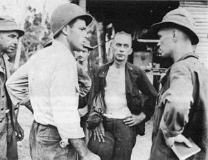 Albert W. Waldron - General Albert W. Waldron (center, facing forward) commanding general, 32nd Division Artillery, discusses plans for the impending battle on 15 November 1942.