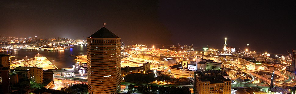 Nighttime view of the port of Genoa, which has brought trade, commerce and wealth to the city for centuries, greatly contributing to its cultural and historical heritage.