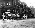 Golden Potlatch Parade, Seattle, float with totem poles (CURTIS 1008).jpeg