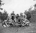 Groep meisjes bezig met koken van een maaltijd en het stoken van vuur, Bestanddeelnr 904-0976.jpg