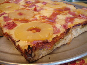 Hawaiian pizza - A slice of Hawaiian pan pizza using pineapple slices