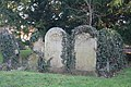 Headstones by the yew tree - geograph.org.uk - 1690256.jpg