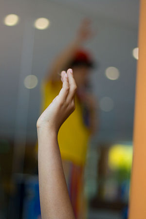 A student raising a hand to ask a question at ...